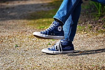 Person wearing blue Converse shoes