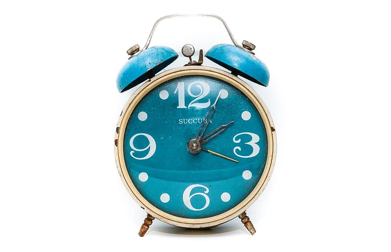 Round brass-colored and blue alarm clock