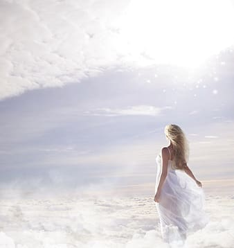 Photo of woman in white spaghetti strap dress on clouds