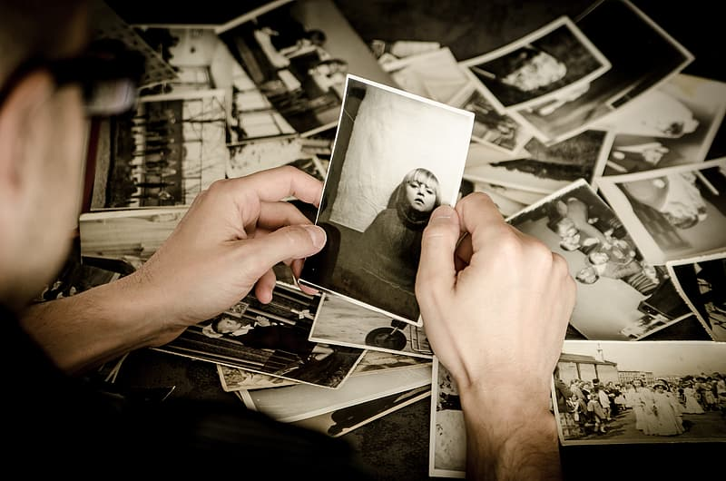 Person holding grayscale photo
