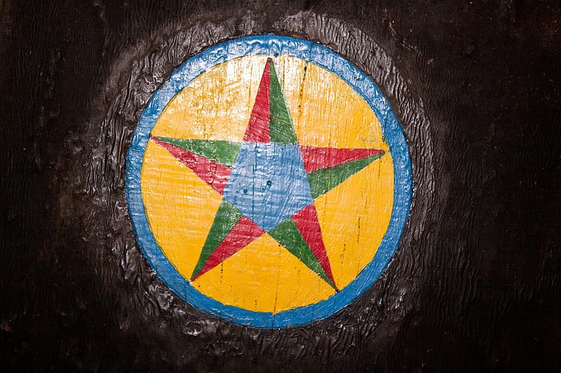 Blue yellow and red round logo