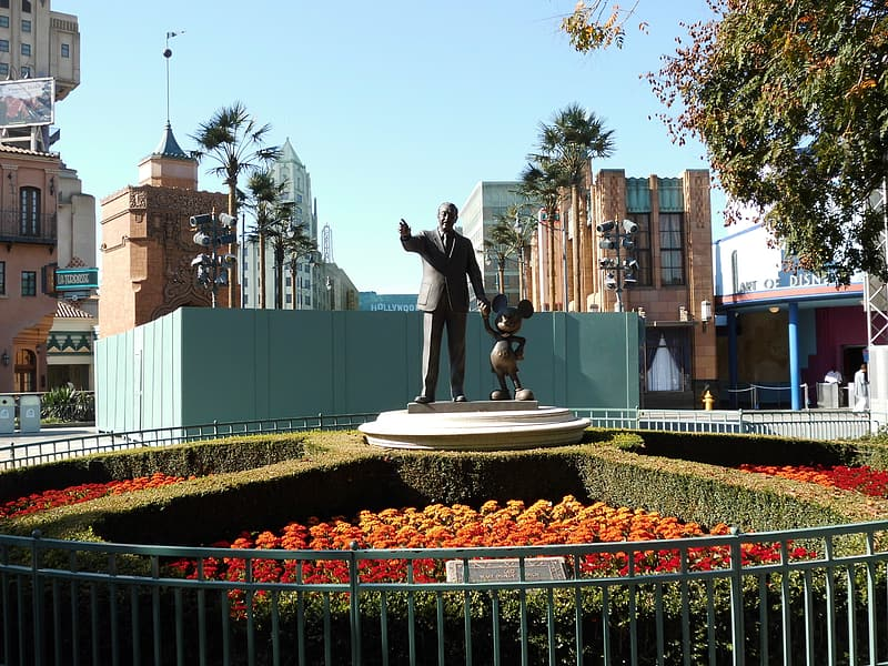 Man and Mickey Mouse statue