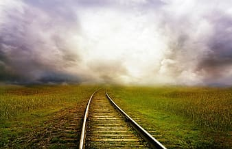 Landscape photography of railway on green grass field