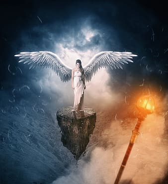 Angel standing on rock with fire