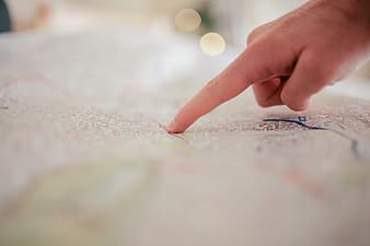 Hand pointing on map