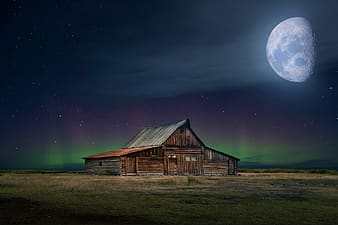 Brown wooden house under starry night