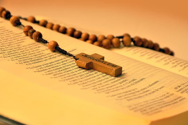 Brown Rosary on Bible book