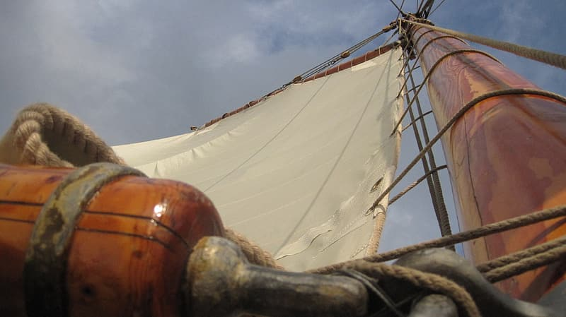 Open sail of brown boat
