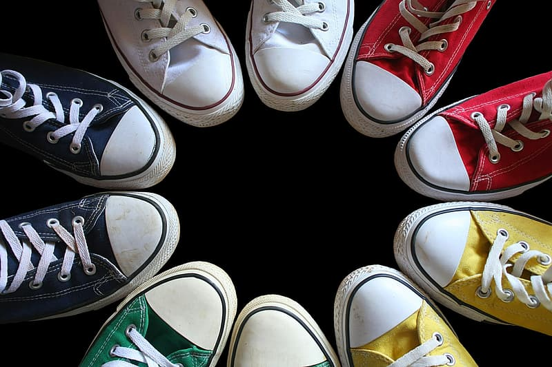 Five pairs of assorted-color Converse All-Star sneakers formed circle