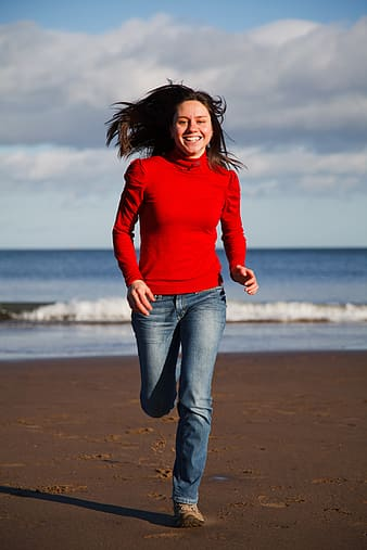 Woman running near sea at daytime