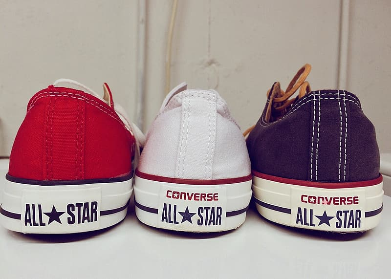 Three unpaired Converse All Star sneakers