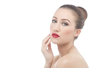 Woman with red lip tint and black eyebrow