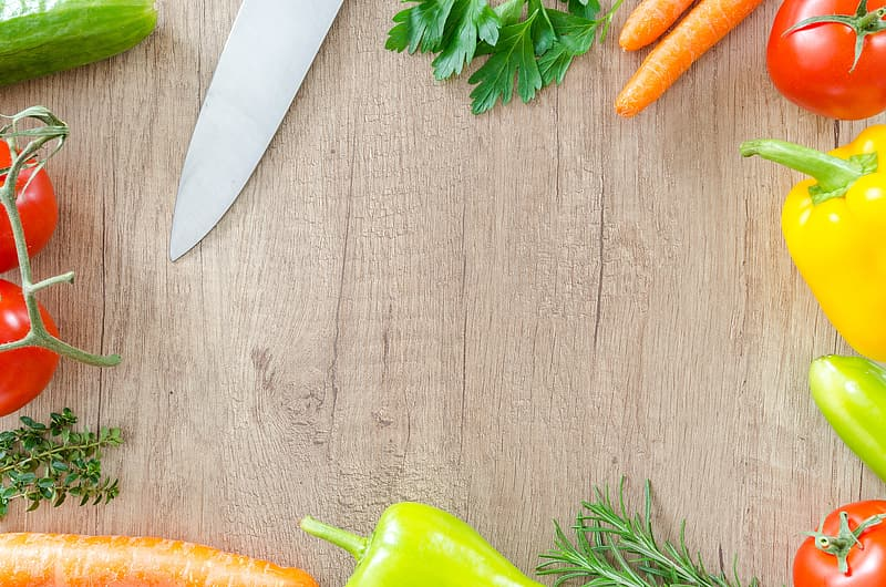Silver kitchen knife and assorted vegetables