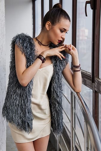 Woman wearing gray fur vest