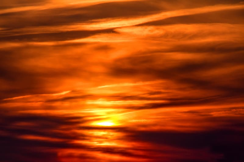 Orange and grey clouds during sunset