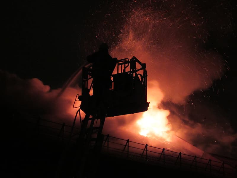 Silhouette of firefighter fighting fire