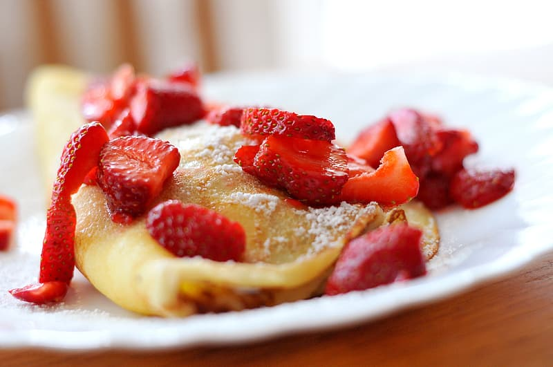 Hot cake with strawberries closeup photography