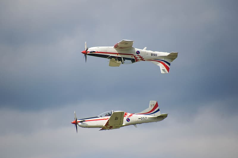 White and red jet plane in mid air
