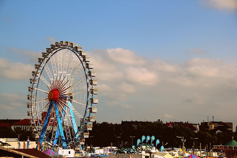 Brown and blue ferris wheel under white cloudy sky during daytime