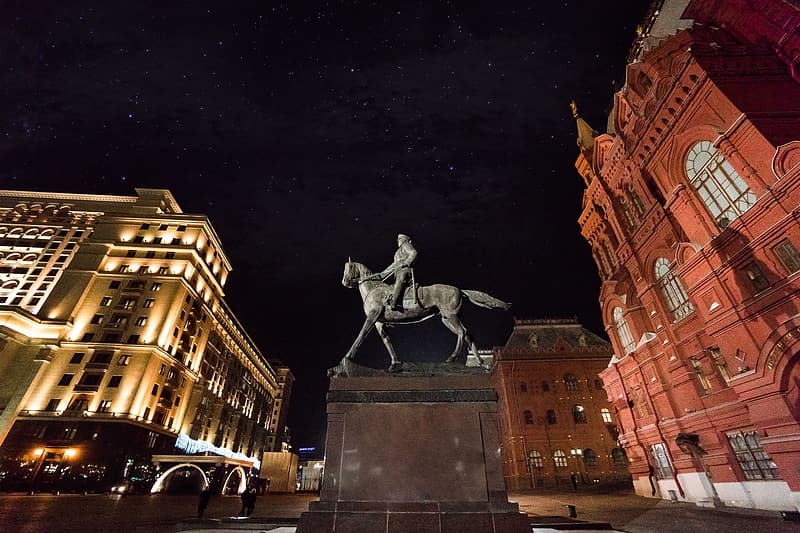 Low-angle photography of man riding horse statue