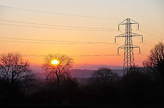 Electricity transformer tower during golden hour