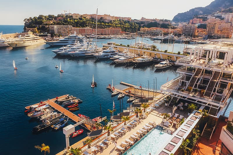 High angle photography of boats and architectures