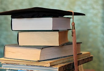Brown and white books on black textile