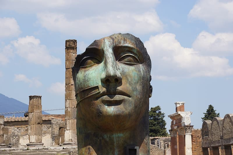 Grey and blue statue head