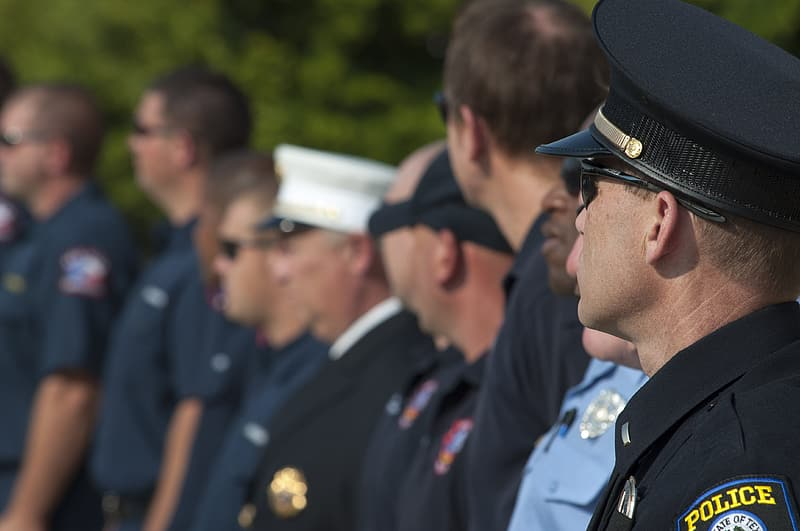 Police officers standing in line during daytime