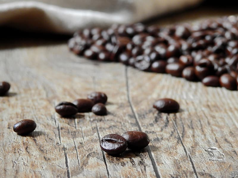 Coffee beans lot on brown wooden table