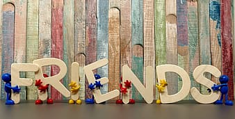 Brown wooden Friends free-standing text