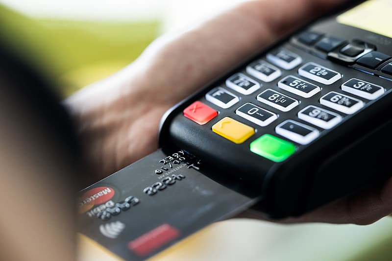 Retail Store Business Owner using Credit Card Terminal