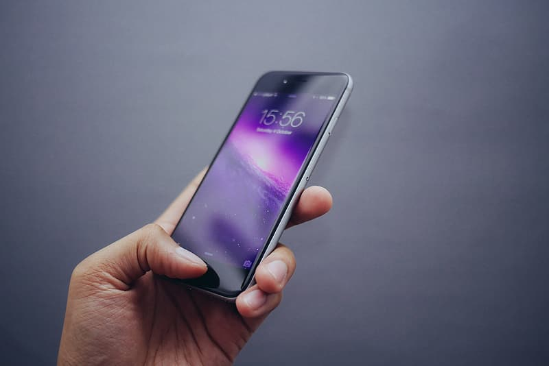 Person holding space gray iPhone 6