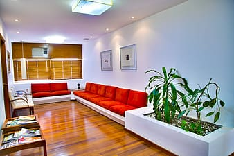 White wooden couches with red pads