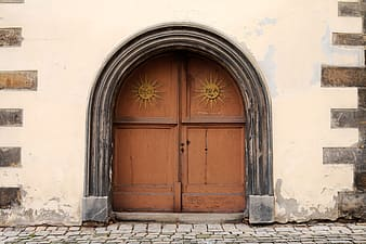 Closed brown wooden doors