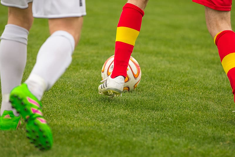 Shallow focus photography of soccer players