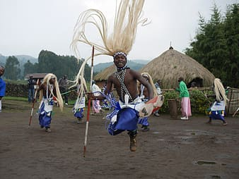 Tribal man dancing with tribe