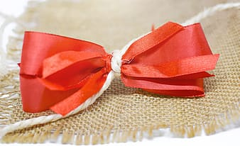 Red ribbon on white textile