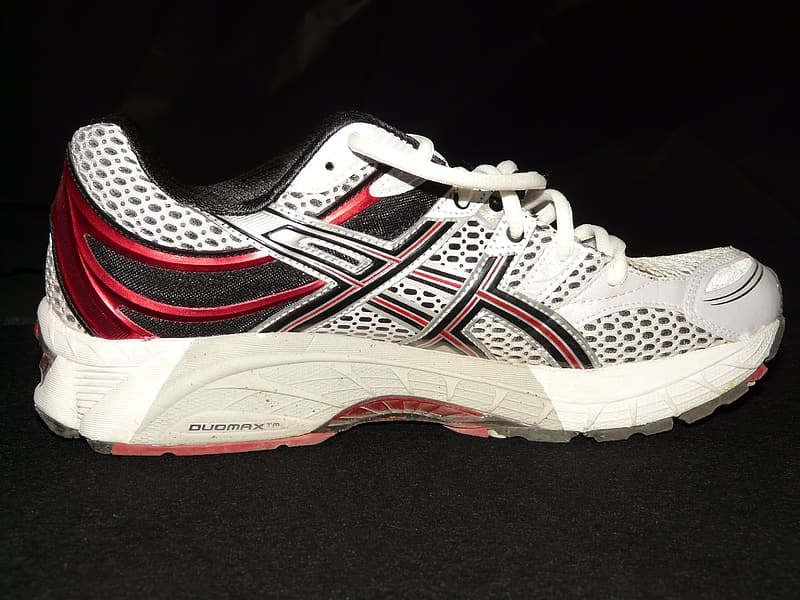 White red and black running shoes