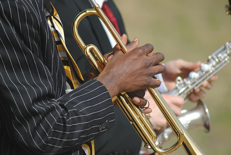 Person playing brass trumpet