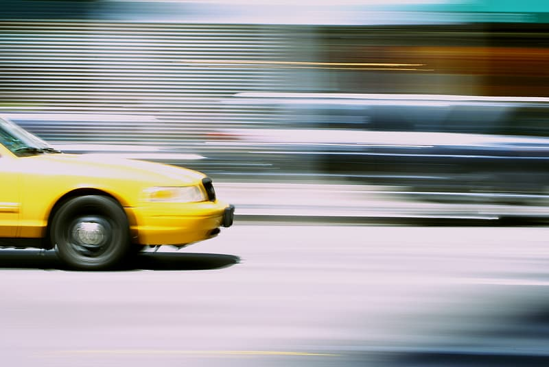 Time lapse photography of yellow car
