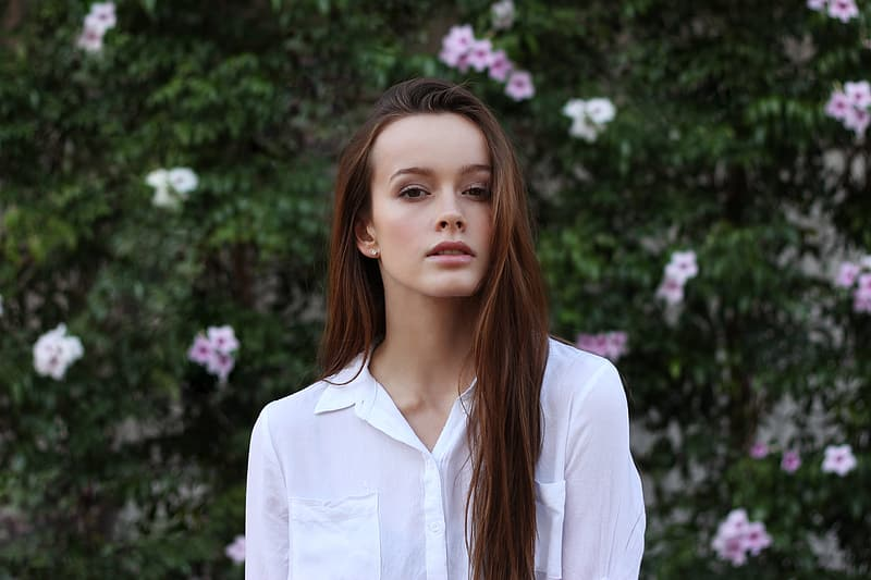 Brown haired woman in white dress shirt