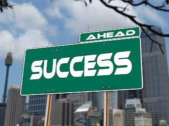 Green and white success signage