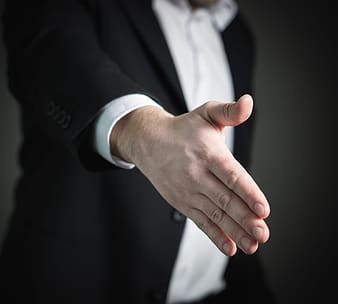 Selective focus photo of man's hand