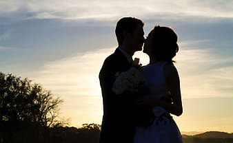Silhouette of man and woman kissing