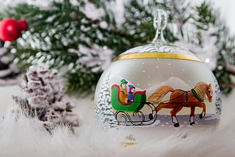 Horse sleigh ornament on white fur textile