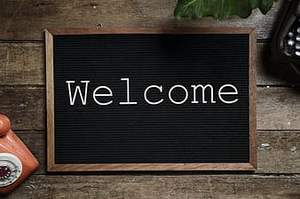 Black and brown wooden welcome signage