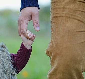 Child and person holding hands