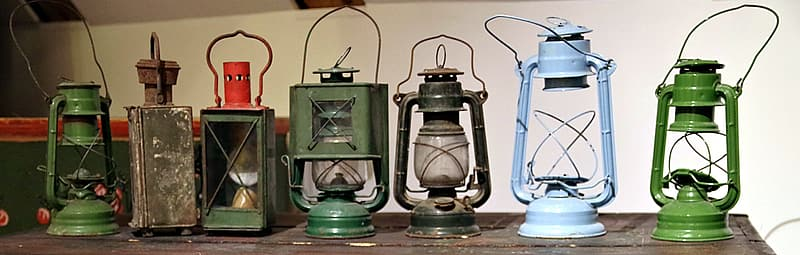 Seven assorted-color lantern lamps on table