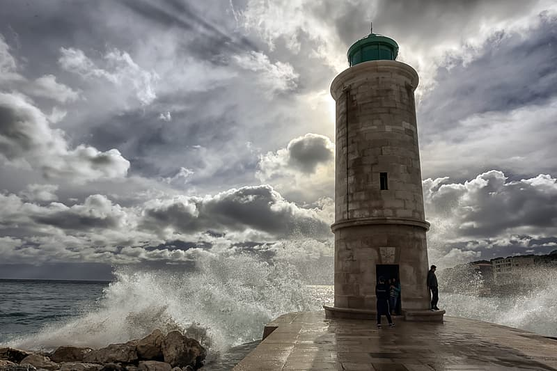 Man leaning on lighthouse